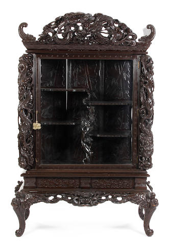 A Chinese carved hardwood display cabinet on stand, early 20th Century Bearing paper label to reverse reading 'Johnson & Sons Ltd., No. 36912, Belfast'