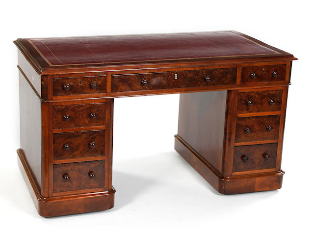 A Victorian walnut and figured walnut pedestal desk, third quarter 19th Century