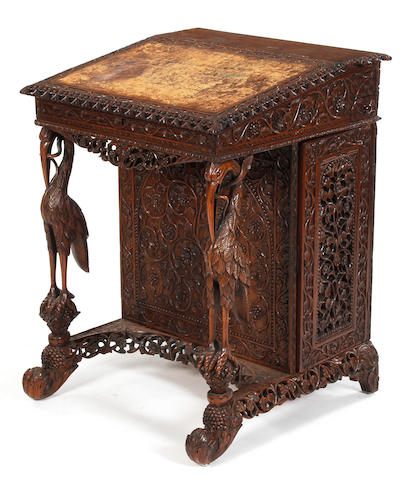 An Anglo-Indian carved padouk Davenport, late 19th Century