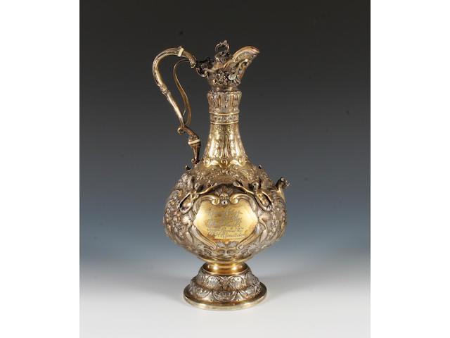 A late Victorian silver gilt Armada pattern ewer By Messrs. Barnard, London, 1899,
