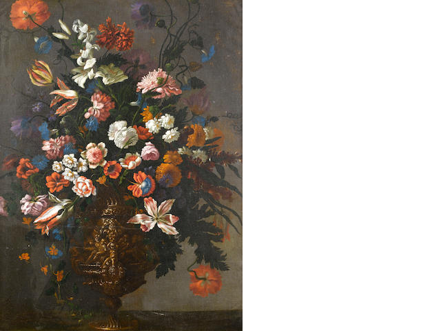 Andrea Scacciati (Florence 1642-1710) Roses, tulips, lilies, convolvulus and other flowers in a silver-gilt urn bearing the Medici coat-of-arms on a table top