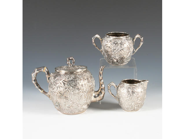 A late 19th/early 20th century Chinese silver three piece tea set By Wang Hing, stamped 'WH 90',  (3)