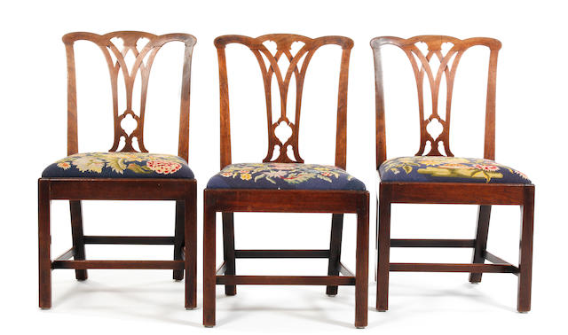 A set of six George III mahogany dining chairs, circa 1770, together with a matching armchair and a matching standard chair, both later copies Forming a near set of eight