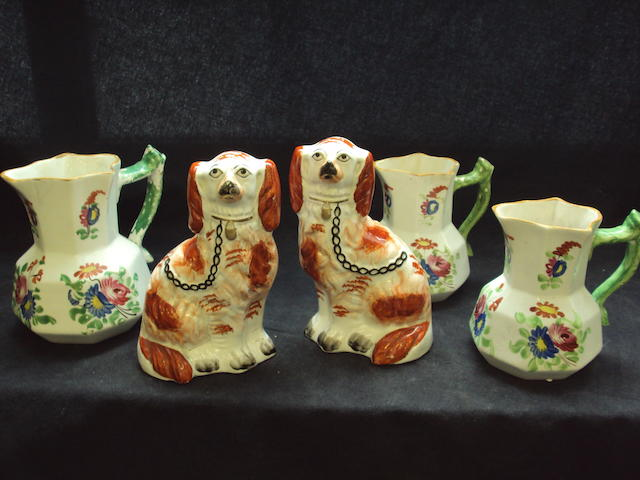 Three Dillwyn pottery jugs and a pair of Staffordshire dogs