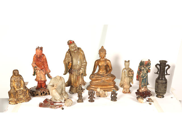 A collection of six Chinese soapstone figures4cm to 26cm high, a South East Asian bronze seated Bodhisttva, a Chinese bronze seated figure, a small archaic style bronze vase, two Indian bronze figures and a Tibetan bronze figure. (12)