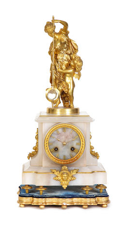 A rare second half of the 19th century French gilt spelter and alabaster mystery clock Guilmet, number 2169, the circular brass base stamped for P H Mourey, 2329