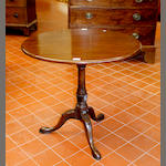 A George III mahogany circular tilt-top tripod occasional table,