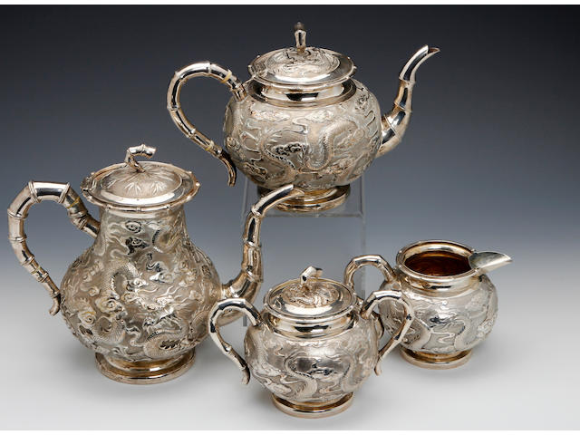 A Chinese silver 4 piece baluster tea & coffee service by KMS, (untraced), possibly Shanghai or Canton circa 1890
