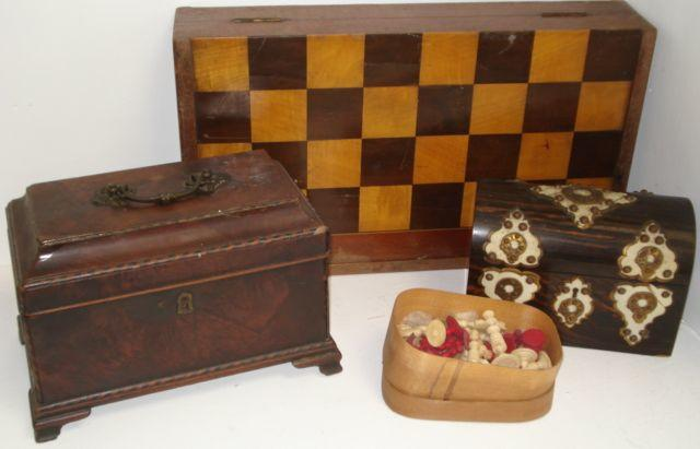 A George III mahogany chequer banded rectangular tea caddy, the moulded hinged cover with a foliate cast swing handle, on ogee bracket feet, 27cm, Victorian coromandel domed top stationary box, with ivory and gilt metal mounts, a Victorian folding games board, with alternate satinwood and walnut chequer board and a 19th Century Indian ivory turned and carved chess set, one half stained as red.