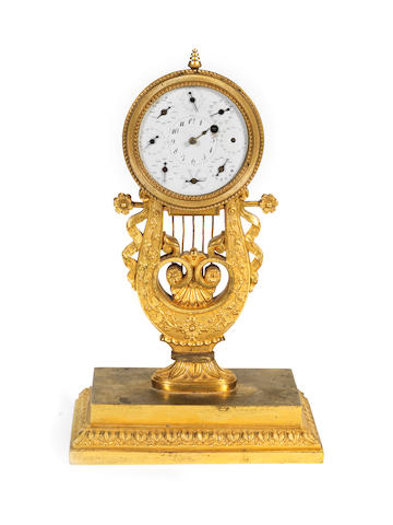 A scarce early 19th century French ormolu Republican perpetual calendar timepiece