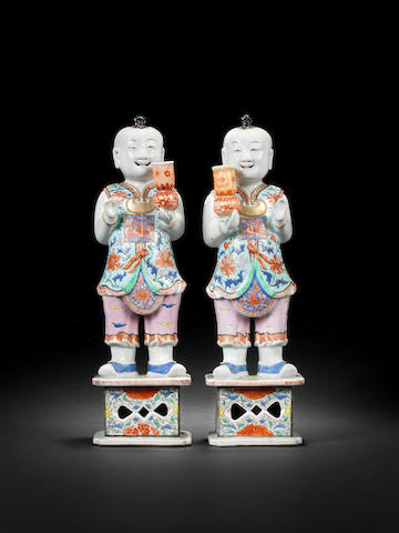 An important pair of large famille rose standing boys Late Yongzheng/Qianlong