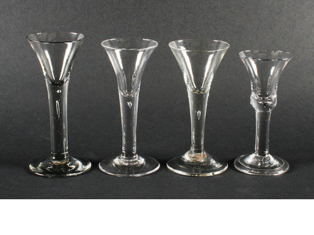 Four plain stem wine glasses, circa 1750