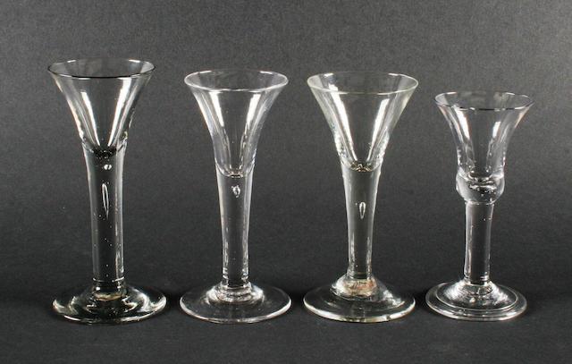 Four plain stem wine glasses, circa 1750