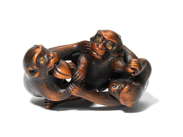 A rare wood netsuke of three monkeys By Naito Toyomasa (1773-1856), Tanba, 1820