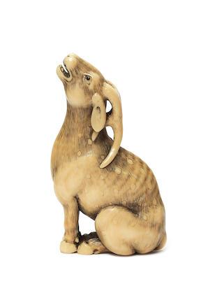 An ivory netsuke of a deer Circa 1800