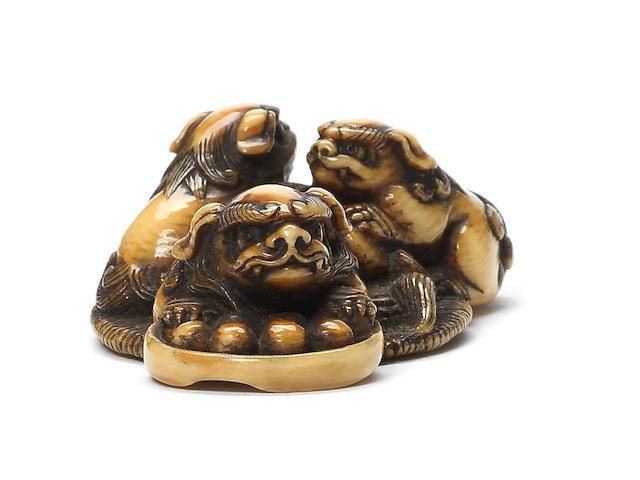 An ivory netsuke of a shishi and cubs Edo, 19th century