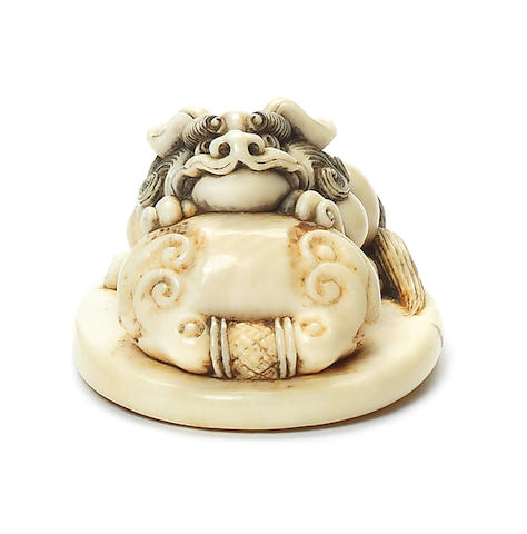 An ivory netsuke of a shishi 19th century