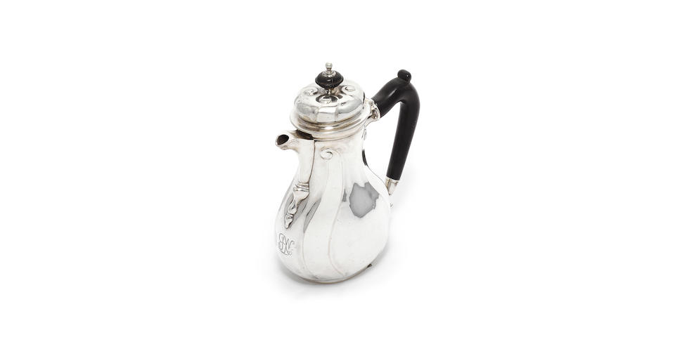 "An 18th century German silver coffee pot, by Johann Erich Conradt Quittenbaum, Hanover, also stamped ""G"","