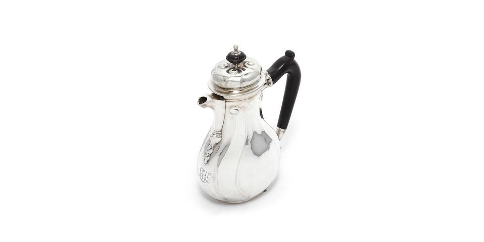 "An 18th century German silver coffee pot, by Johann Erich Conradt Quittenbaum, Hanover, also stamped ""G"","