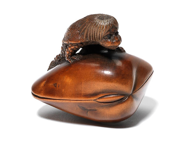 A wood netsuke of Kappa By Suketada, Takayama, 19th century