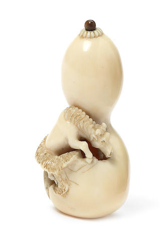 An ivory netsuke of a horse 19th century