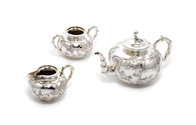 A late 19th / early 20th century Chinese export silver three-piece tea service, by Wang Hing & Co, Hong Kong,  (3)