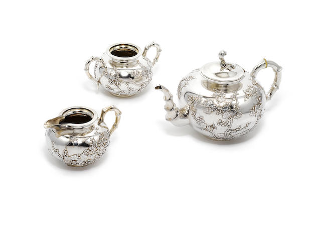 A late 19th / early 20th century Chinese Export silver three piece tea service, by Wang Hing & Co, Hong Kong,  (3)