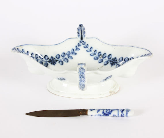 A rare Meissen sauceboat, circa 1780, together with a Meissen knife handle
