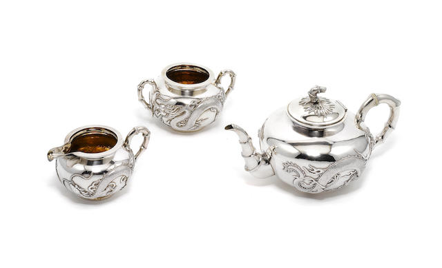A 19th century Chinese Export  silver three piece tea service, by Wang Hing & Co,   Hong Kong,  (10)