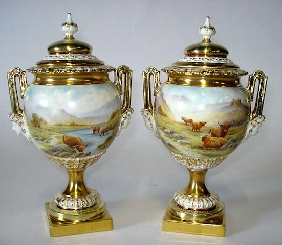 A pair of modern Royal Worcester limited edition 'Highland Cattle' vases in the style of Stinton