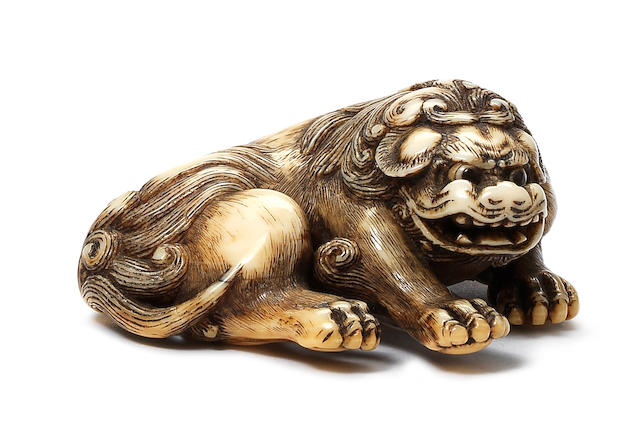 An ivory netsuke of a shishi By Yoshinaga, Kyoto, late 18th century