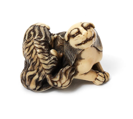 An ivory netsuke of a shishi and cub Late 18th century