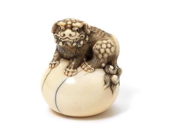 An ivory netsuke of a shishi Kyoto, early 19th century