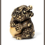 An ivory netsuke of Shishi By Mitsuharu, Kyoto, Late 18th century