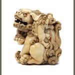 An ivory netsuke of a shishi and cub Kyoto, late 18th century