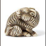 An ivory netsuke of a goat By Okatori, Kyoto, early 19th century