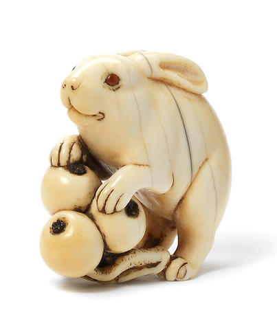 An ivory netsuke of a hare By Okatori, Kyoto, early 19th century