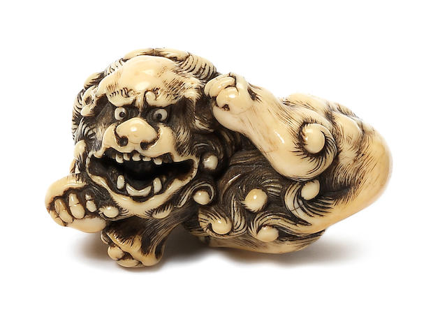 A small ivory netsuke of a shishi By Risuke Garaku, Osaka, late 18th century
