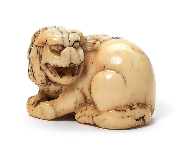 A small ivory netsuke of a shishi 18th century