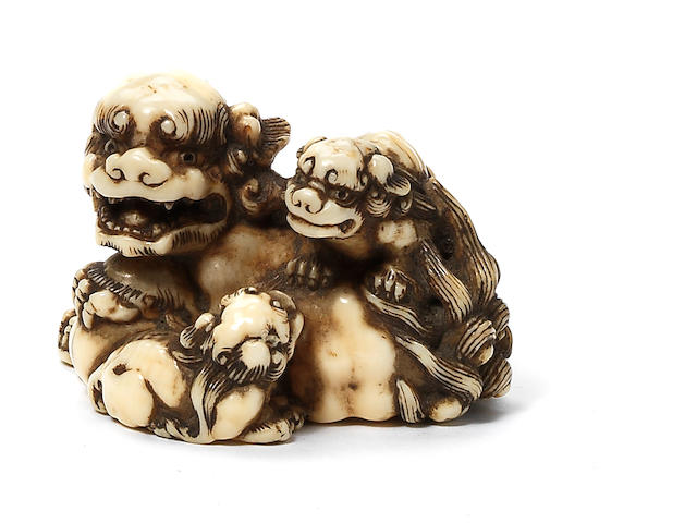 An ivory netsuke of a shishi and cubs By Toshihide (Juei), 19th century