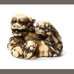 An ivory netsuke of a shishi and cubs By Toshihide (Juei)), 19th century