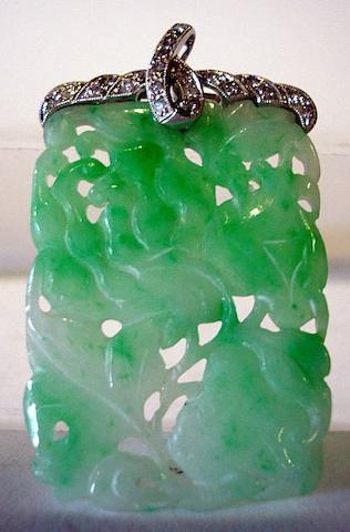 An apple-green jadeite and diamond pendant
