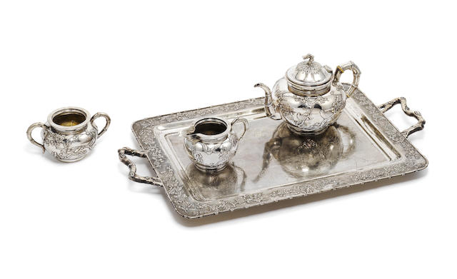 A late 19th / early 20th century Chinese export silver three-piece tea service and two handled tray, by Luen Wo, Shanghai,  (4)