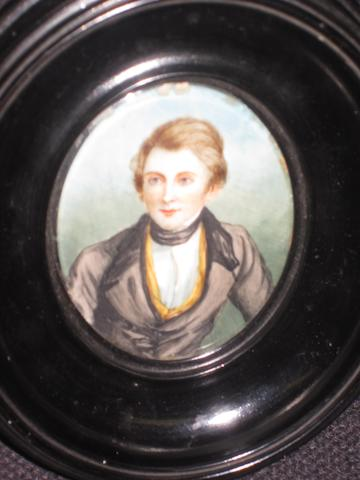 English School, mid or later 19th century A portrait miniature of a gentleman, identified as John Ruskin, wearing white shirt and dark jacket, oval