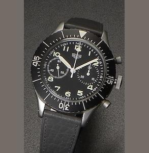 Heuer. A stainless steel manual wind flyback chronograph wristwatch Ref:1550 SG