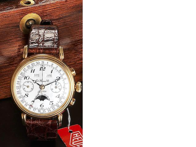 Ed.Heuer & Co. An 18ct gold manual wind calendar moonphase chronograph wristwatch with wooden presentation box No.004
