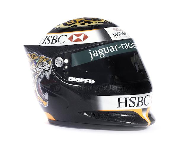 An Eddie Irvine Jaguar used promotional helmet by Bieffe, with signed race-used visor,