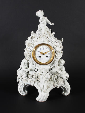 A Dresden white rococo clock case, late 19th century