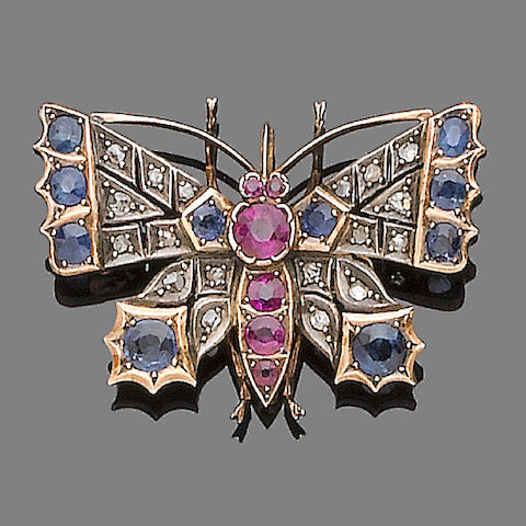 A sapphire, ruby and diamond butterfly brooch