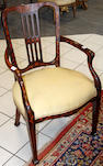 An 18th century style Dutch mahogany and inlaid elbow chair